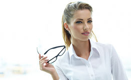 Businesswoman standing outside a house Stock Photo