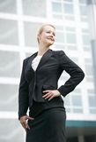 Businesswoman standing outside the office building Stock Images