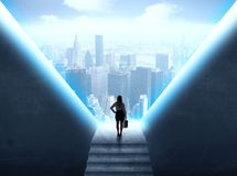 Businesswoman looking at a cityscape royalty free stock photos