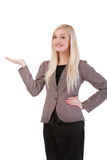 Businesswoman standing smiling holding her hand showing somethin Stock Photos