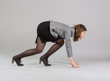 Businesswoman standing in start position Royalty Free Stock Image