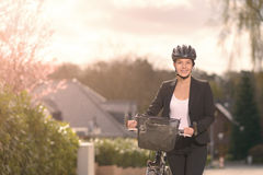 Businesswoman standing on the Street with bike Royalty Free Stock Photo