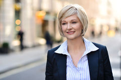 Businesswoman standing in street Royalty Free Stock Photo