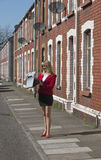 Businesswoman standing in street looking at briefcase Royalty Free Stock Photos