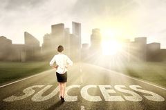 Businesswoman standing on the success way Stock Images