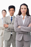 Businesswoman standing with team and folded arms Royalty Free Stock Image