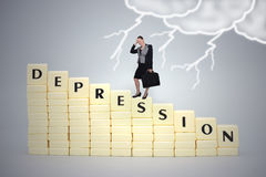 Businesswoman standing on a text on depression, on a gray background. Stock Photography