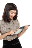 Businesswoman standing with touch pad Stock Images