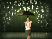 Businesswoman standing with umbrella and 3d numbers raining conc Royalty Free Stock Image