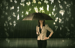 Businesswoman standing with umbrella and 3d numbers raining conc Royalty Free Stock Photos