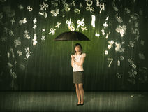 Businesswoman standing with umbrella and 3d numbers raining conc Stock Image