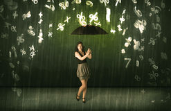Businesswoman standing with umbrella and 3d numbers raining conc Royalty Free Stock Photography