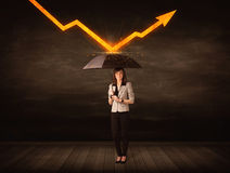 Businesswoman standing with umbrella keeping orange arrow Stock Images