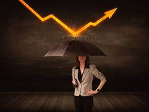 Businesswoman standing with umbrella keeping orange arrow Stock Photography