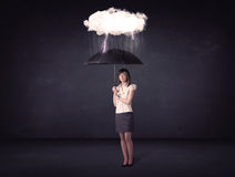 Businesswoman standing with umbrella and little storm cloud Royalty Free Stock Photography