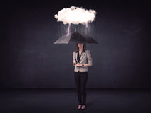 Businesswoman standing with umbrella and little storm cloud Royalty Free Stock Photos