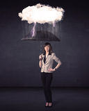 Businesswoman standing with umbrella and little storm cloud Stock Images