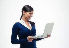 Businesswoman standing and using laptop Royalty Free Stock Photo