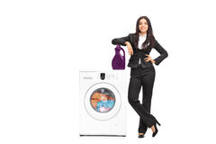 Businesswoman standing by a washing machine Stock Image