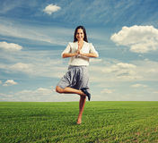 Businesswoman standing in yoga pose Stock Photo