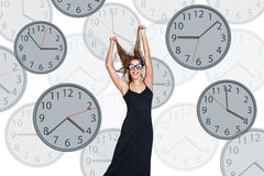 Businesswoman stands among clocks. Stock Photo