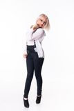 Businesswoman stands near a chair Stock Image