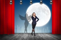 Businesswoman stands on the scene with curtains Stock Photography