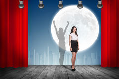 Businesswoman stands on the scene with curtains Royalty Free Stock Photo