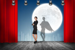 Businesswoman stands on the scene with curtains Royalty Free Stock Photos