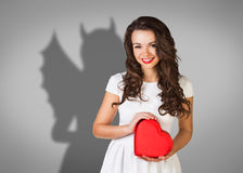 Businesswoman stands with shadow on the wall Stock Images