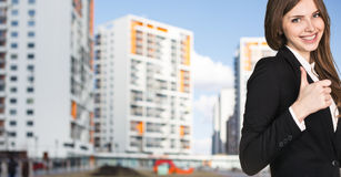 Businesswoman stands on the street. In the city Stock Images