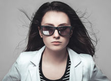 Businesswoman staring through sunglasses Stock Photography