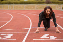 Businesswoman in a Start Position on Race Track Stock Photos