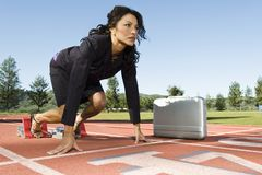 Businesswoman At The Starting Blocks With Briefcase Royalty Free Stock Photography