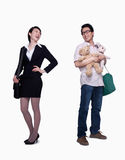 Businesswoman and stay in home father, opposite, studio shot Royalty Free Stock Image