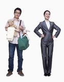 Businesswoman and stay in home father, studio shot Stock Image