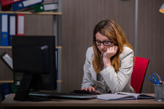 The businesswoman staying in the office for long hours Royalty Free Stock Photo