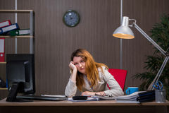 The businesswoman staying in the office for long hours Stock Images