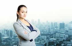 Businesswoman staying over city view Stock Image