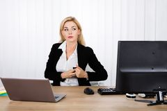 Businesswoman Stealing Stapler Secretly. A Suspicious Businesswoman Stealing Stapler Secretly In Her Pocket At Office royalty free stock image