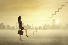 Businesswoman step on stair for success Stock Image