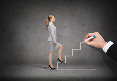 Businesswoman stepping up staircase. Business and education concept - businesswoman stepping up staricase Royalty Free Stock Photo
