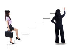 Businesswoman stepping up on stairs to success 1 Royalty Free Stock Images