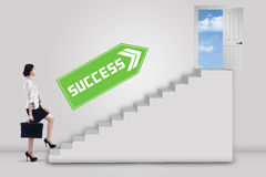 Businesswoman stepping up to success 1 Royalty Free Stock Photography