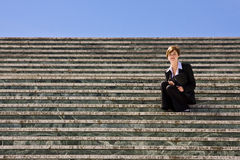 Businesswoman on steps Stock Photo