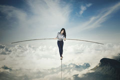 Businesswoman with a stick over mountains Stock Images