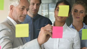 Businesswoman sticking sticky notes stock footage
