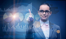 The businesswoman in stock exchange trading concept Stock Photos