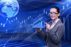The businesswoman in stock trading business concept Stock Photos