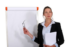 Businesswoman stood by flip chart Royalty Free Stock Photo